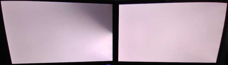A pair of LCD screens set to display all white. The left screen's backlight is dying in its top right corner.